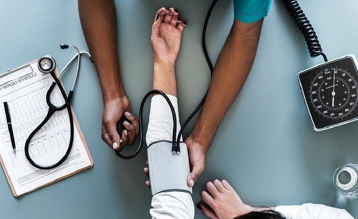 A person having their blood pressure taken at the doctors