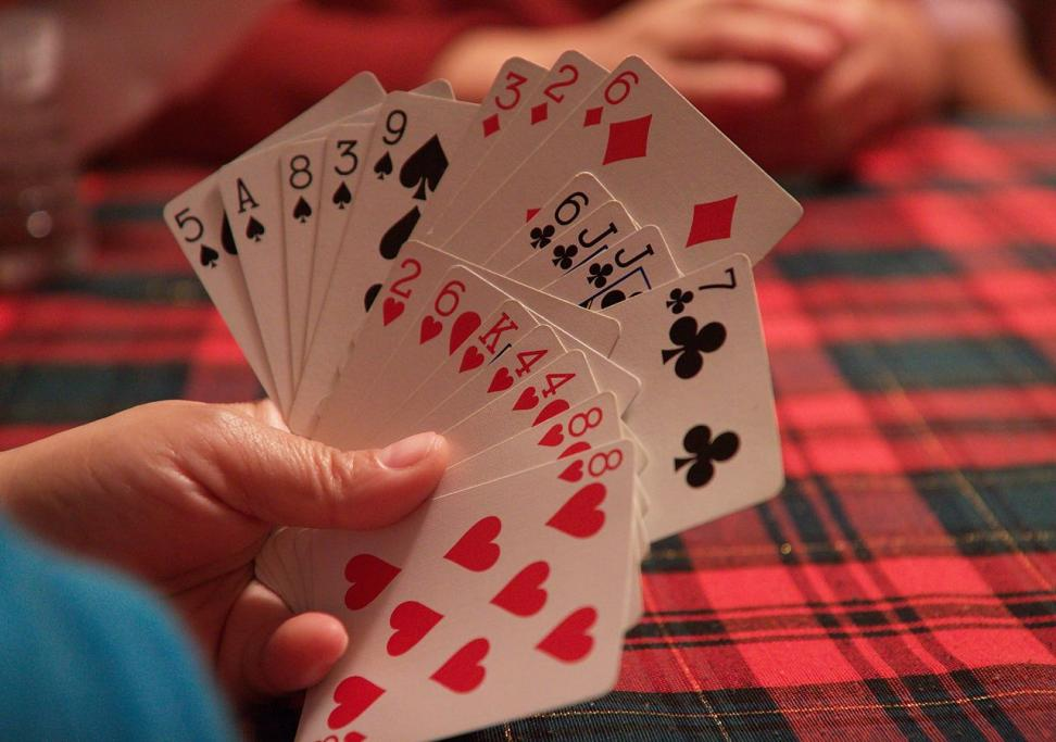 Hand of cards in play