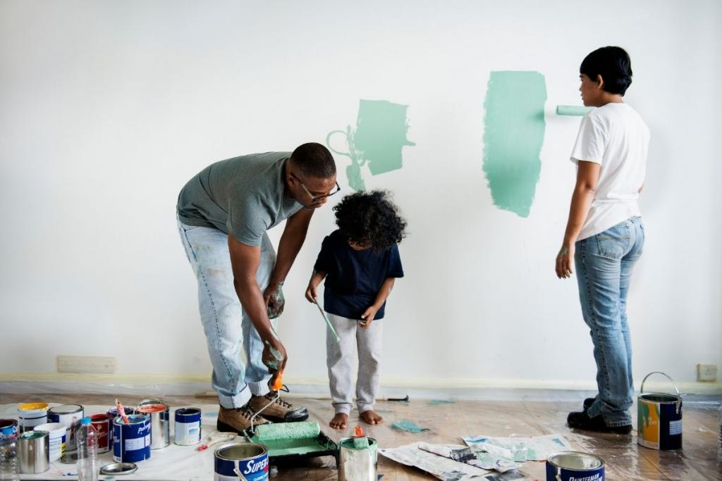 Family painting living room