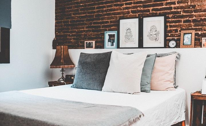 A bedroom with the bed made